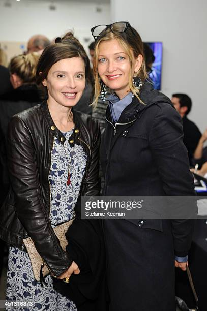 Eve McGregor and Christine attend The Rema Hort Mann Foundation LA Artist Initiative Benefit Auction on November 21 2013 in Los Angeles California