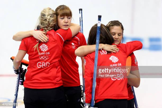 Eve Muirhead, Anna Sloan, Vicki Adams, and Claire Hamilton of Great Britain console each other after losing to Canada during the women's semifinal...