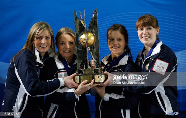Eve Muirhead, Anna Sloan, Vicki Adams and Claire Hamilton pose with the trophy after winning the Gold medal match between Sweden and Scotland on Day...