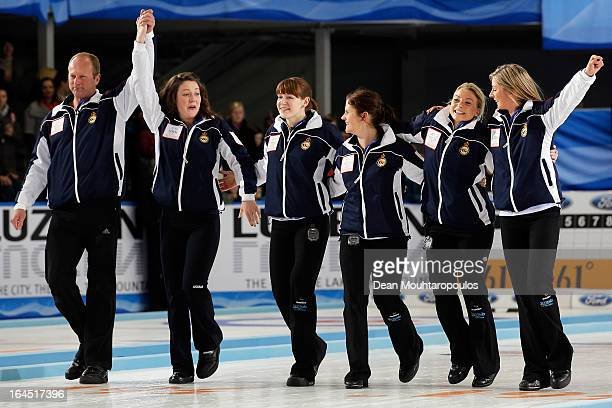 Eve Muirhead Anna Sloan Vicki Adams Claire Hamilton Lauren Gray and Coach David Hay celebrate after winning the Gold medal match between Sweden and...