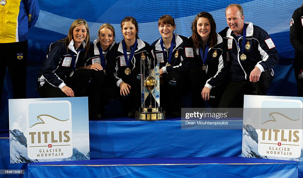 Eve Muirhead, Anna Sloan, Vicki Adams, Claire Hamilton, Lauren Gray and Coach, David Hay pose with the trophy after winning the Gold medal match between Sweden and Scotland on Day 9 of the Titlis Glacier Mountain World Women's Curling Championship at the Volvo Sports Centre on March 24, 2013 in Riga, Latvia.