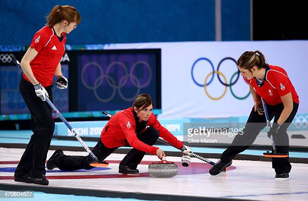 Eve Muirhead of Great Britain plays the final stone alongside Claire Hamilton and Vicki Adams during the Bronze medal match between Switzerland and...