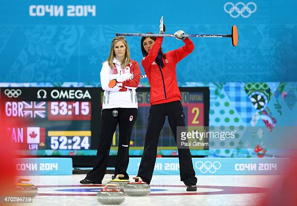 Eve Muirhead of Great Britain signals to her team-mates as Jennifer Jones of Canada looks on during the women's semifinal match between Great Britain...