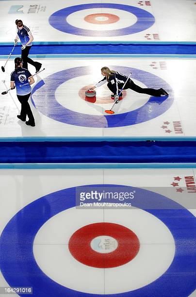 Eve Muirhead of Scotland throws a stone as Vicki Adams and Claire Hamilton get ready to sweep in the match between Scotland and Sweden on Day 7 of...
