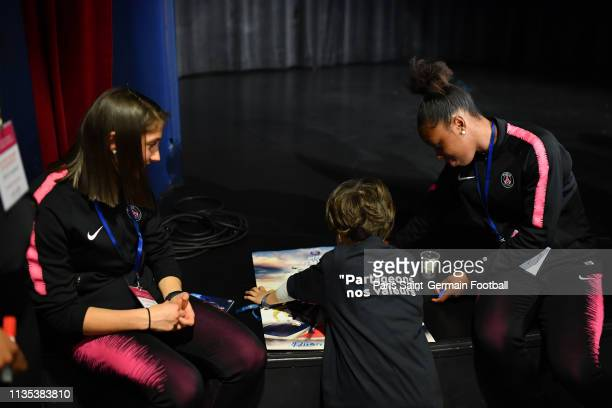 Eve Perisset and Aminata Diallo speak with a child at Neck Hospital on March 12 2019 in Paris France