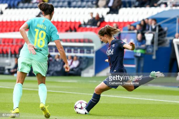 Eve Perisset of Paris SaintGermain is shooting the ball against Marta Torrejon of FC Barcelona during the Women's Champions League match between...