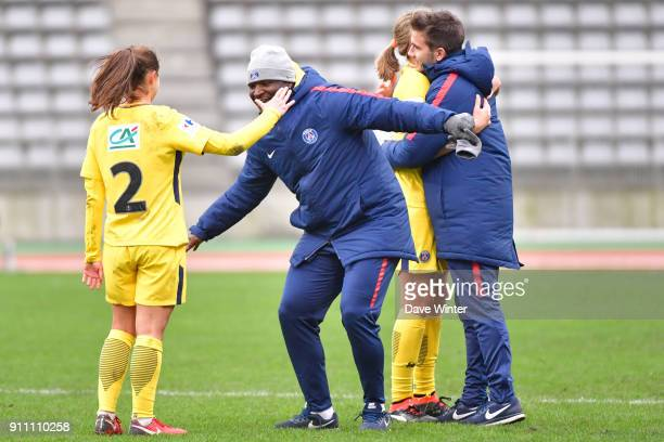Eve Perisset of PSG celebrates with PSG assistant coach Bernard Mendy after their side wins during the Women's National Cup match between Paris FC...