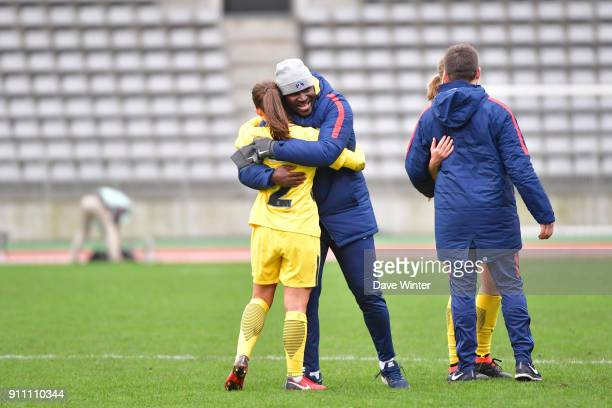 Eve Perisset of PSG celebrates with PSG assistant coach Bernard Mendy after their side wins the Women's National Cup match between Paris FC and Paris...
