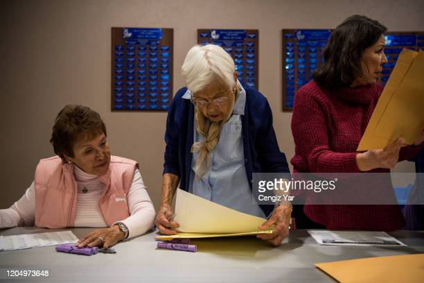 Eve Rey Angie Martinez and Maria Zurlinden sort and file election material at the El Paso County Court House on March 3, 2020 in El Paso, Texas....
