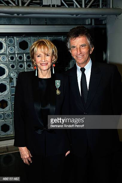 Eve Ruggieri dressed with Smoking Pierre Cardin and Jack Lang attend the Eve Ruggieri decorated Officier des Arts et Lettres by Jack Lang President...