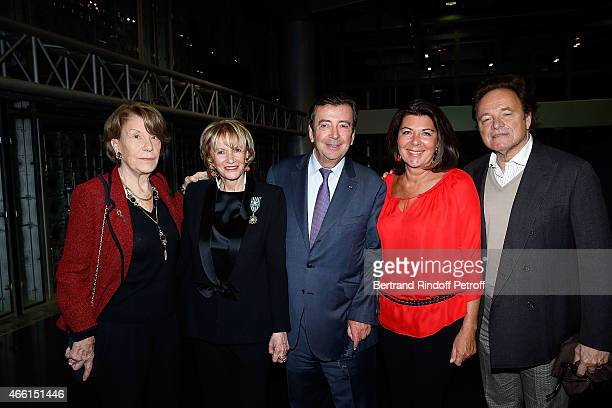 Eve Ruggieri dressed with Smoking Pierre Cardin Philippe Faure and his wife Christine and Guillaume Durand attend the Eve Ruggieri decorated Officier...