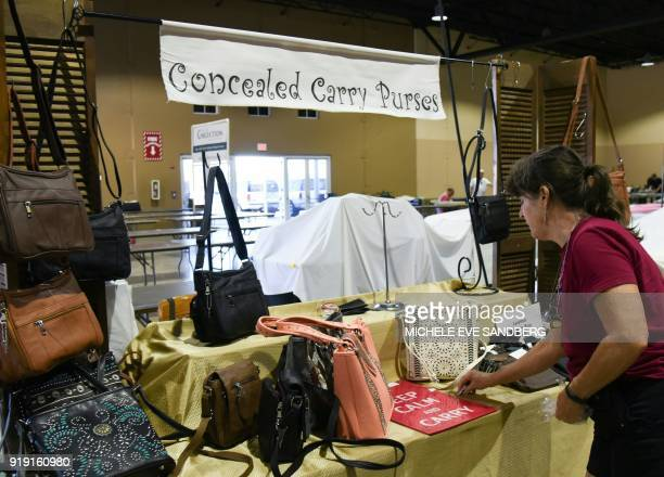 Eve Silverbach sets up her 'Concealed Carry Purses' booth and shows how the gun fits in the bag on February 16 2018 during preparations for the...