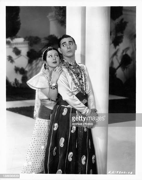 Eve Sully holding onto Eddie Cantor in a scene from the film 'Kid Millions' 1934