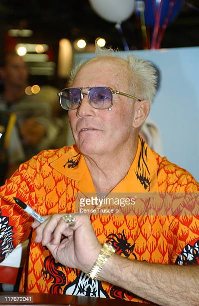 Evel Knievel signs autographs at his 64th birthday celebration on October 17 2002 in Las Vegas