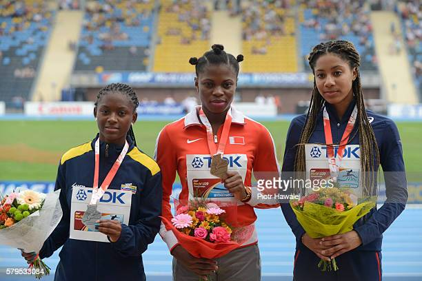 Evelin Rivera from Colombia Edidiong Ofonime Odiong from Bahrain and Estelle Raffai from France on the podium after women's 200 metres during the...