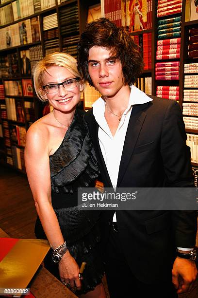 Evelina Khromtchenko and Alexandre Assouline attend the Evelina Khromtchenko Paris book launch at the Assouline Library on July 6 2009 in Paris France