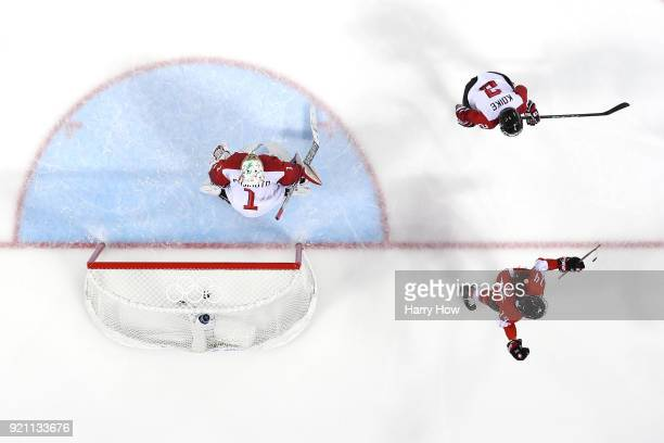 Evelina Raselli of Switzerland celebrates after scoring against Nana Fujimoto of Japan in the first period during the Women's Ice Hockey...