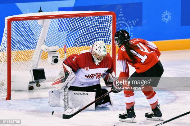 Evelina Raselli of Switzerland scores a goal against Nana Fujimoto of Japan in the first period during the Women's Ice Hockey Classification game...