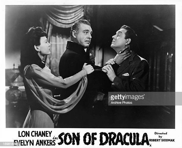 Evelyn Ankers holds back Lon Chaney Jr from Robert Paige in a scene from the film 'Son Of Dracula' 1943