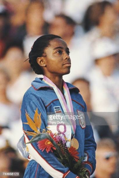 Evelyn Ashford of the United States stands on the podium after receiving her gold medal for winning the Women's 100m metres event at the XXIII...