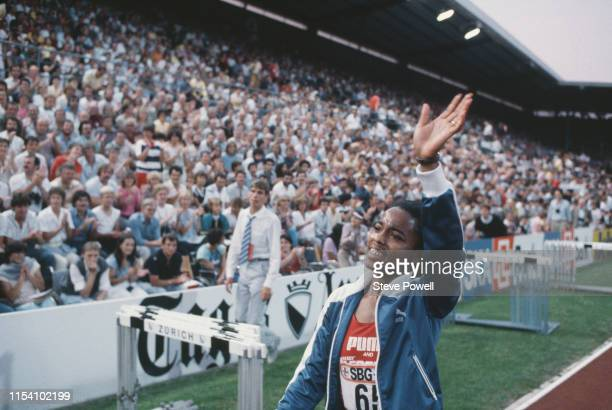 Evelyn Ashford of the United States waves to the crowd in celebration after sprinting to a new Women's 100 meter world record in a time of 1076...