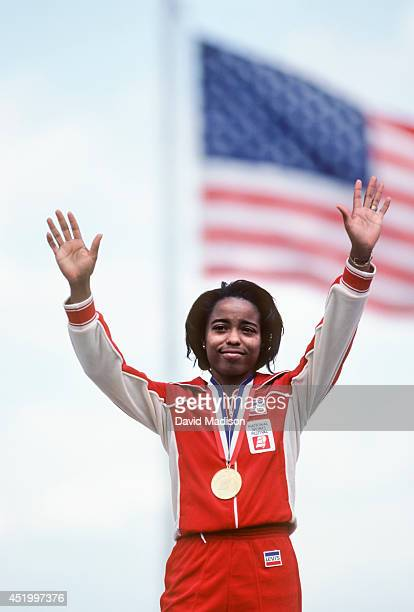 Evelyn Ashford of the USA acknowledges the crowd during the awards ceremony for the Women's 100 meter race at the 1983 National Sports Festival track...