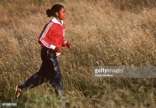 Evelyn Ashford of the USA jogs during training in June 1980 in the hills near Palo Alto California