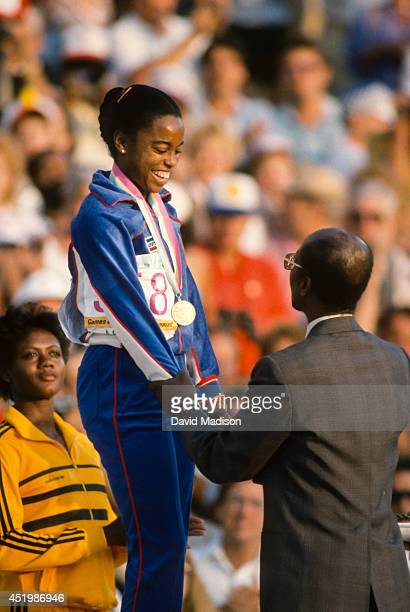 Evelyn Ashford of the USA receives her gold medal for the Women's 100 meter event of the track and field competition of the 1984 Olympic Games on...