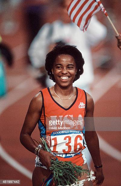 Evelyn Ashford of the USA smiles at the crowd following an awards ceremony during the track and field competition in August 1990 of the 1990 Goodwill...