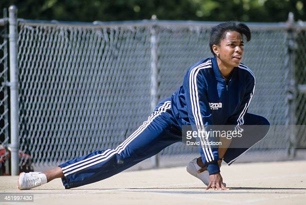 Evelyn Ashford stretches on the track before competing in the 1986 USA/Mobil Outdoor National Championships held during June 1986 at Hayward Field at...