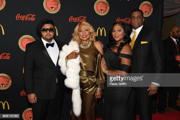 Evelyn Braxton and Trina Braxton with guests attend the 26th Annual Trumpet Awards at Cobb Energy Performing Arts Center on January 20, 2018 in...