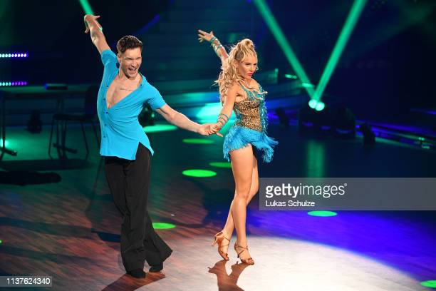Evelyn Burdecki and Evgeny Vinokurov perform on stage during the 1st show of the 12th season of the television competition Let's Dance on March 22...