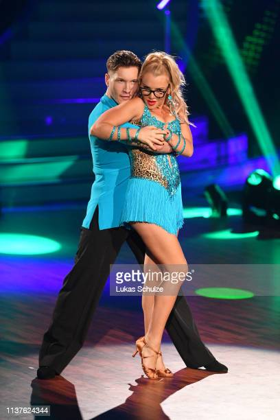 "Evelyn Burdecki and Evgeny Vinokurov perform on stage during the 1st show of the 12th season of the television competition ""Let's Dance"" on March 22,..."