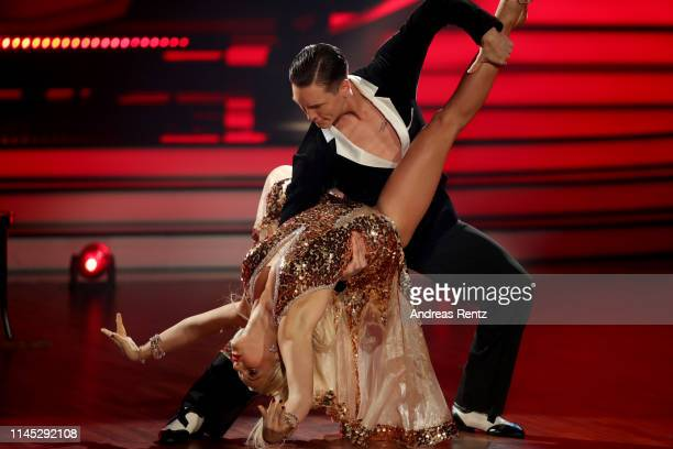 "Evelyn Burdecki and Evgeny Vinokurov perform on stage during the 5th show of the 12th season of the television competition ""Let's Dance"" on April 26,..."