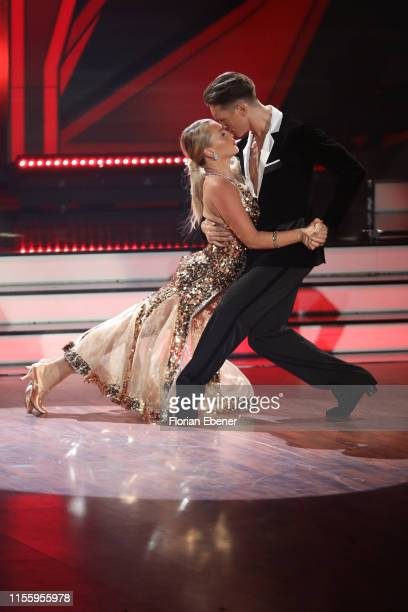 "Evelyn Burdecki and Evgeny Vinokurov perform on stage during the finals of the 12th season of the television competition ""Let's Dance"" on June 14,..."