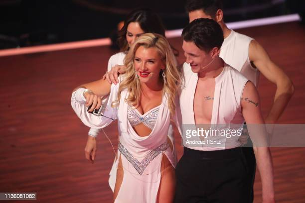 Evelyn Burdecki and Evgeny Vinokurov smile during the preshow 'Wer tanzt mit wem Die grosse Kennenlernshow' of the television competition 'Let's...