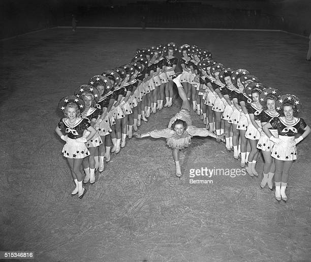 """Evelyn Chandler does a spiral as the chorus forms a """"V"""" during the dress rehearsal for the ice Follies of 1941 opening in Madison Square Garden."""