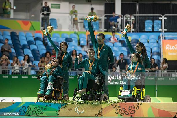 Evelyn de Oliveira, Antonio Leme and Evani Soares da Silva of Brazil celebrate their gold medal on the podium in the Boccia - Mixed Pairs - BC3 Gold...