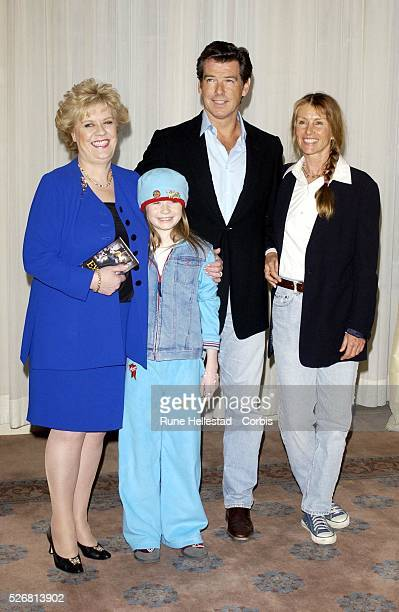 Evelyn Doyle Sophie Vavasseur Pierce Brosnan and Beau StClair attend a photocall for Evelyn at Claridges hotel