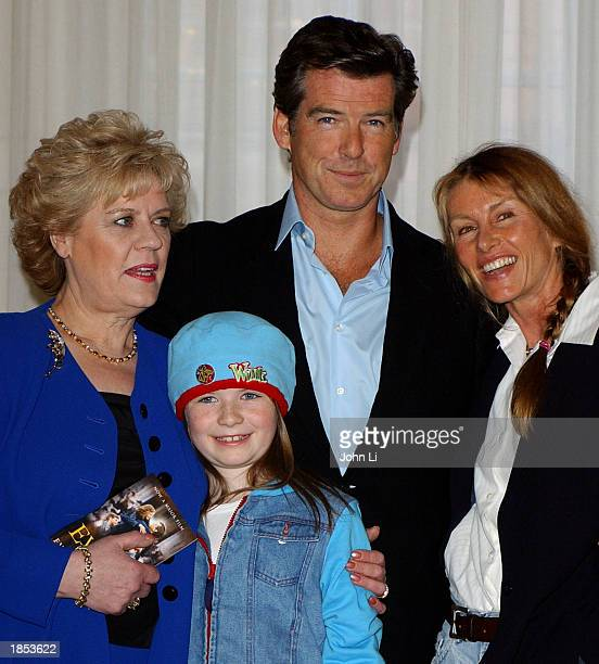 Evelyn Doyle the real life inspiration for the film actress Sophie Vavasseur actor Pierce Brosnan and producer Beau St Clair attend a photocall at...