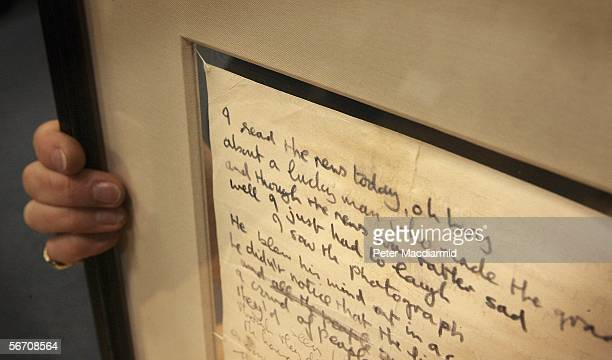 Evelyn Durnford of Bonhams holds John Lennon's original first draught of the lyrics to the Beatle's 'A Day In The Life' are displayed on January 31...