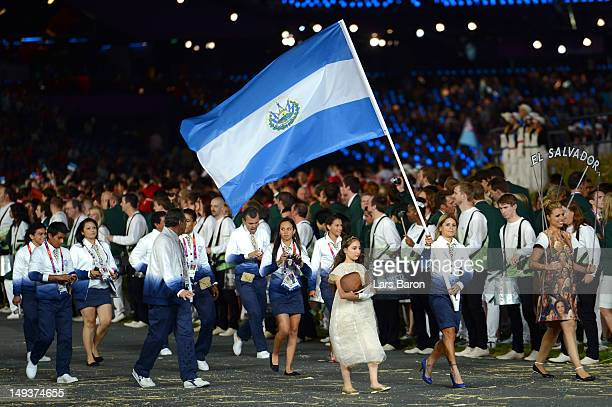 Evelyn Garcia of the El Salvador Olympic cycling team carries her country's flag during the Opening Ceremony of the London 2012 Olympic Games at the...