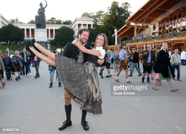 Evelyn Greffenius and her husband Philip Greffenius during the 'Almauftrieb' as part of the Oktoberfest 2017 at Kaeferschaenke Tent on September 17...