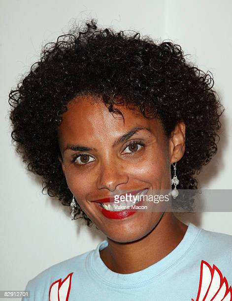 Evelyn JeanLouis Jimmy JeanLouis' wife attends the opening of Jeffery Dread's Exhibit Human Footprint The Impact hosted by Trigg Ison Fine Art...