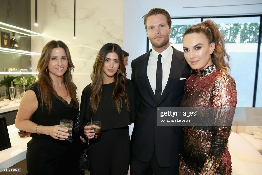 Evelyn Karamanos, Kelsey White, host Armie Hammer and actor Elizabeth Chambers attend the private Hennessy X.O on Ice dinner, in Beverly Hills, CA on May 10, 2017. The dinner served to unveil Hennessy X.O's new 3-D printed ice bucket designed by architect Paul McClean. The ice bucket encourages serving Hennessy X.O, the world's original Extra Old Cognac, on ice to best enjoy the spirit's multisensory taste odyssey.