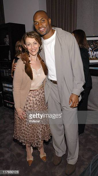 Evelyn Lauder and Amani Toomer of the NY Giants during New York Sports Night at the Esquire Apartment at The Esquire Apartment in New York City New...