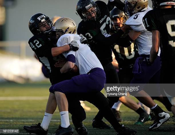D'Evelyn LB Mike Doyle left sacks Holy Family QB David Sommers in the 2nd half of the game at Trailblazer Stadium on Friday Hyoung Chang / The Denver...