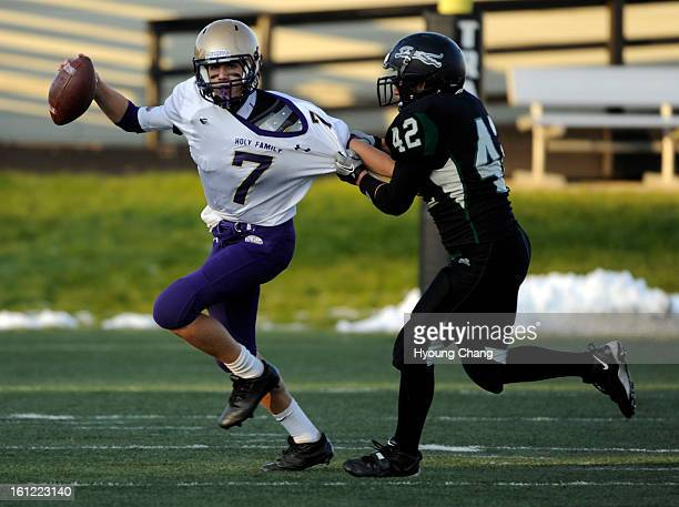 D'Evelyn LB Mike Doyle right sacks Holy Family QB David Sommers in the 2nd half of the game at Trailblazer Stadium on Friday Hyoung Chang / The...