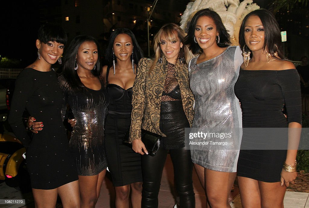 Evelyn Lozada (C) poses with friends at Chad Ochocino's birthday party at Prime 112 on January 20, 2011 in Miami Beach, Florida.