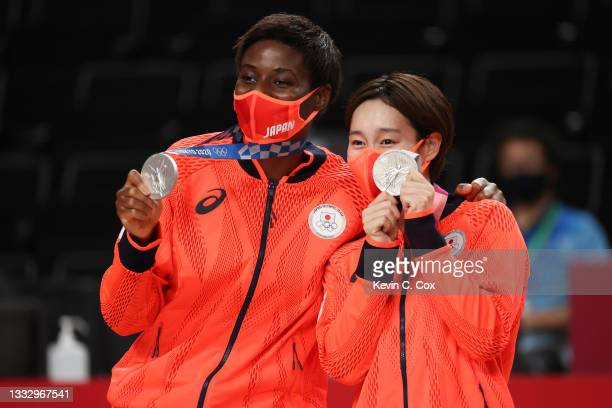 Evelyn Mawuli and Saori Miyazaki of Team Japan pose for photographs with their silver medals during the Women's Basketball medal ceremony on day...